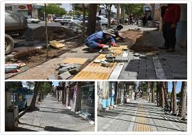 بهسازی و موزائیک فرش پیاده روی ضلع جنوبی خیابان شهاب